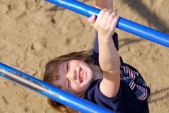 Recess!. Swinging from the monkey bars on recess Royalty Free Stock Images