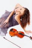 At recess. Young woman posing with violin Royalty Free Stock Photos