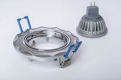 Recessed ceiling light and LED lamp to him. Chrome LED lamp and luminaire for suspended ceilings Stock Photo