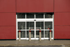 Recession - 2. Front entrance of super-store, doors closed and chained;  no customers, no stock, closed in early 2009 Royalty Free Stock Images