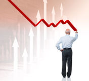 Recession. Back view of businessman and 3d chart stock photo