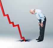 Recession. Old man look falling financial line royalty free stock photos