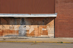 Recession. Yet another boarded store at a strip mall royalty free stock image