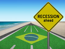 Recession ahead sign leading to Rio games. Brazilian flag Running track with words Recession ahead leading to Rio de Janeiro, Brazil at the beach Royalty Free Stock Image