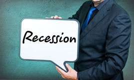 Recession businessman. A businessmann with a whiteborad text is recession Royalty Free Stock Images