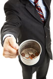 Recession - Businessman Panhandling. Businessman begging for change in his tin cup. White background royalty free stock photography