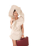 Recession businesswoman. Sad recession businesswoman dressed in torn paper dress with briefcase royalty free stock photography