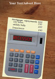 Recession calculator on old pine table. Calculator with the word recession in red LCD set out on A piece of paper listing monthly outgoings. Three of the Royalty Free Stock Photos