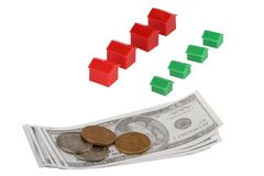 Recession Concept with Money and Toy Houses. Money and toy houses recession concept isolated on white royalty free stock image