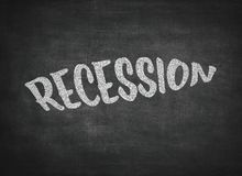 Recession concept word on a blackboard background. The word recession written on a blackboard stock photos
