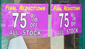 Recession continues; shop closed. Signs in shop window 'Final reductions 75% off all stock' and now shop emptied of stock, concept of continuing recession Royalty Free Stock Photos