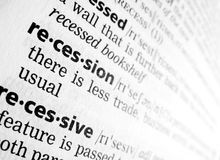 Recession in dictionary. The word 'recession' as shown in an English language dictionary, focused. Diagonal of the page suggests moving down, declining trend royalty free stock images