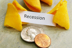 Recession fortune. Fortune cookie with Recession message and coins stock image