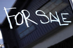 Recession Image Of For Sale Sign On Abandoned Buil Stock Photo