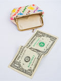 Recession; my last Dollar. An empty purse with a single dollar in the foreground Royalty Free Stock Image