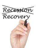 Recession and recovery concept. Hand crossing over recession and writing recovery on copy space on virtual whiteboard / screen. Easily replaced with your own royalty free stock photos