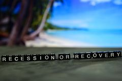 Recession or recovery on wooden blocks. Business and finance concept. Cross processed image with bokeh background stock photos