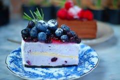 Receta del pastel de queso del arándano foto de archivo