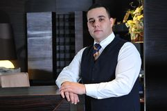 Recetion man in hotel Stock Images