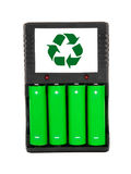 Recharchable green batteries with black charger on. Eko green batteries with charger Stock Photo