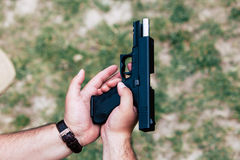 Recharge the gun in your hand. Training on shooting Royalty Free Stock Photos