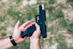 Recharge the gun in your hand. Training on shooting Royalty Free Stock Images