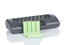 Rechargeable batteries and charger royalty free stock photography