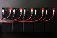 Rechargeable batteries, and electrical wires. Industrial battery Royalty Free Stock Photography