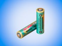 A rechargeable battery. Against blue background Royalty Free Stock Photography