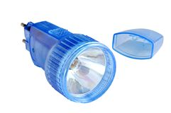 Rechargeable flashlight in a blue plastic case. Against white background Stock Photography