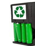 Rechargeable green batteries with black charger on. Recharchable green batteries on white Stock Image