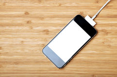 Rechargeable smartphone Stock Images