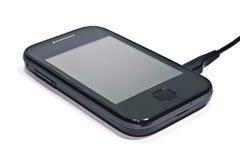 Recharging cellphone Royalty Free Stock Photos