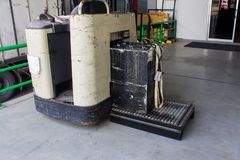 Recharging electric for forklift, battery charger and conveyor. Recharging electric for forklift, battery charger and conveyor royalty free stock images