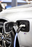 Recharging of hybrid BMW car. BMW ActiveHybrid technology unites a combustion engine and electric drive Royalty Free Stock Photos