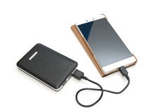 Recharging smart phone tablet from power bank. Isolate Stock Photography