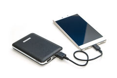 Recharging smart phone tablet from power bank. Isolate Royalty Free Stock Photo