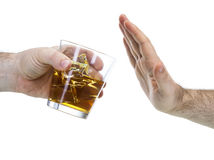 Rechazo de la mano al vidrio de whisky Foto de archivo libre de regalías