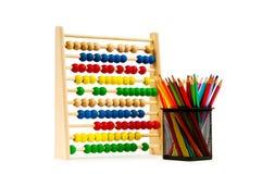 Rechenmaschine und Bleistifte trennten Stockfotografie