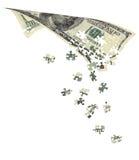 Rechnungen 100$, zerlegt in Puzzlespiele Stockbilder