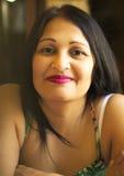 Recht asiatische Frau von mittlerem Alter Stockfotos