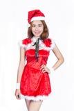 Recht asiatisches Mädchen in Sankt-Kostüm für Weihnachten auf weißem backgr Lizenzfreies Stockbild