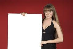 Recht blond mit bekanntmachendem Blatt Stockfotografie