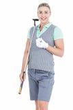 Recht blonde Aufstellung mit Golfausrüstung Lizenzfreie Stockfotografie