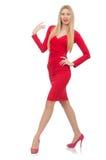 Recht blonde Dame im roten Kleid lokalisiert auf Weiß Lizenzfreie Stockfotografie