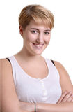 Recht blonde Frau, die auf weißer Wand sich lehnt Lizenzfreies Stockbild