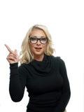 Recht blondes Frauenzeigen Stockfotos