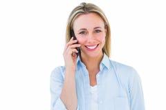 Recht blondes Lächeln am Telefon Lizenzfreie Stockbilder