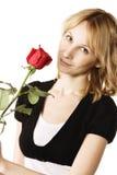 Recht Blondine mit rosafarbener Blume Stockfotografie