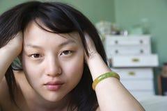 Recht junge asiatische Frau. Stockbilder
